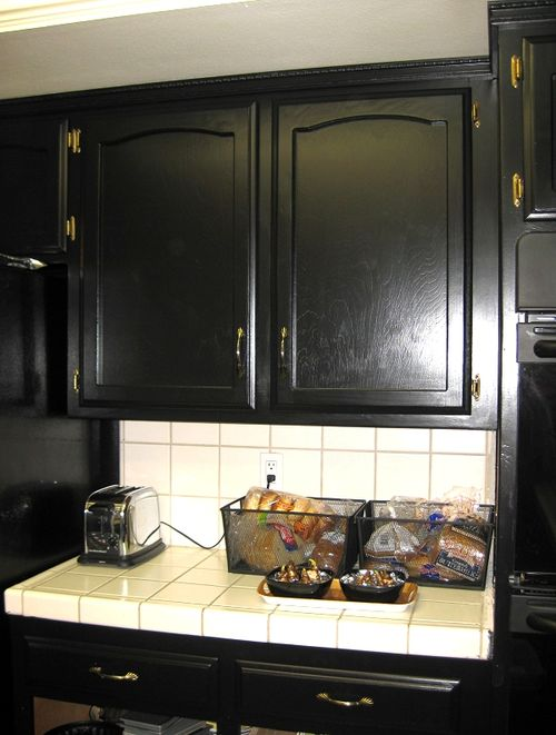 The same upper cabinet after the doors and ceiling strip molding went up. Adding decorative trim adds a layer of luxury and kicks everything up a notch. & Auction Girl Vintage: Met Monday ~ Black Kitchen Cabinets